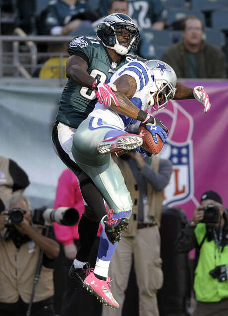 Cowboys cornerback Brandon Carr intercepts a pass intended for Eagles wide receiver Jason Avant, part of the team's improved execution on defense. Photo: Michael Perez / Associated Press