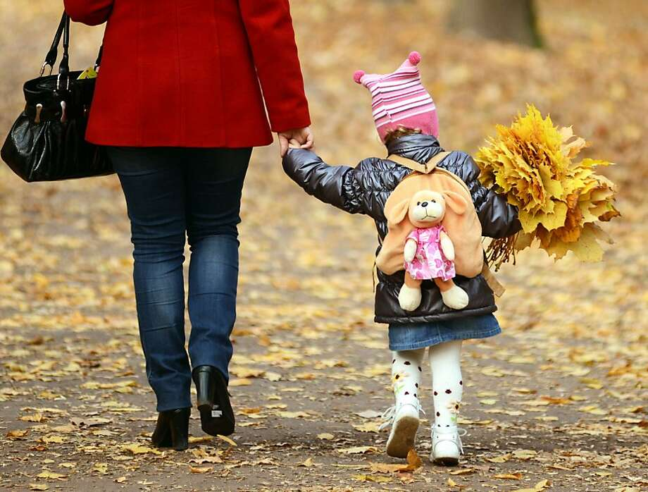 Just as pretty as flowers:A girl carries a bouquet of golden leaves during a warm autumn day in Lviv, Ukraine. Photo: Yurko Dyachyshynurko, AFP/Getty Images