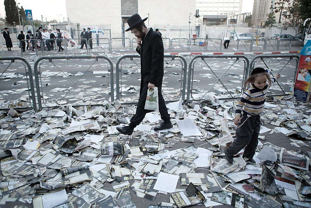 An Ultra-orthodox Jewish man walks at a street covered with election campaign leaflets in Jerusalem on October 21, 2013 on the eve of Israel's municipal elections. TOPSHOTS/AFP PHOTO/MENAHEM KAHANAMENAHEM KAHANA/AFP/Getty Images