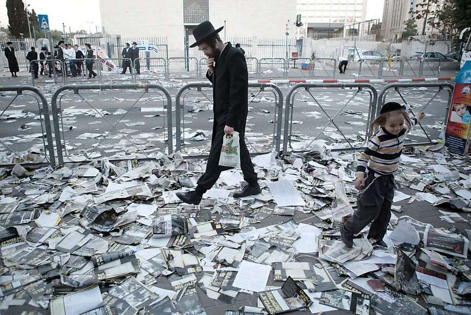An Ultra-orthodox Jewish man walks at a street covered with election campaign leaflets in Jerusalem on October 21, 2013 on the eve of Israel's municipal elections.    TOPSHOTS/AFP PHOTO/MENAHEM KAHANAMENAHEM KAHANA/AFP/Getty Images Photo: Menahem Kahana, AFP/Getty Images