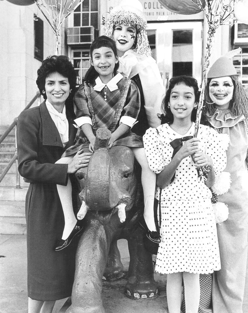 Mary Alice Cisneros (left) and daughters Mercedes, sitting on the elephant, and Teresa help to kick off an evening under the big top to benefit the preservation of the Hertzberg Circus Museum in February 1984. Clowns Roberta and Doreen of Balloon Talk help clown it up.