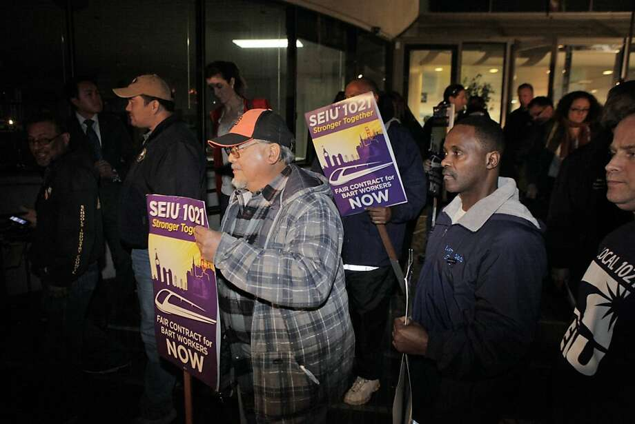 Members of SEIU leave after BART management and its unions have announced a tentative agreement in their labor negotiations on Monday night, October 21, 2013, in Oakland, Calif., and an end to the 4-day labor strike. Photo: Carlos Avila Gonzalez, The Chronicle