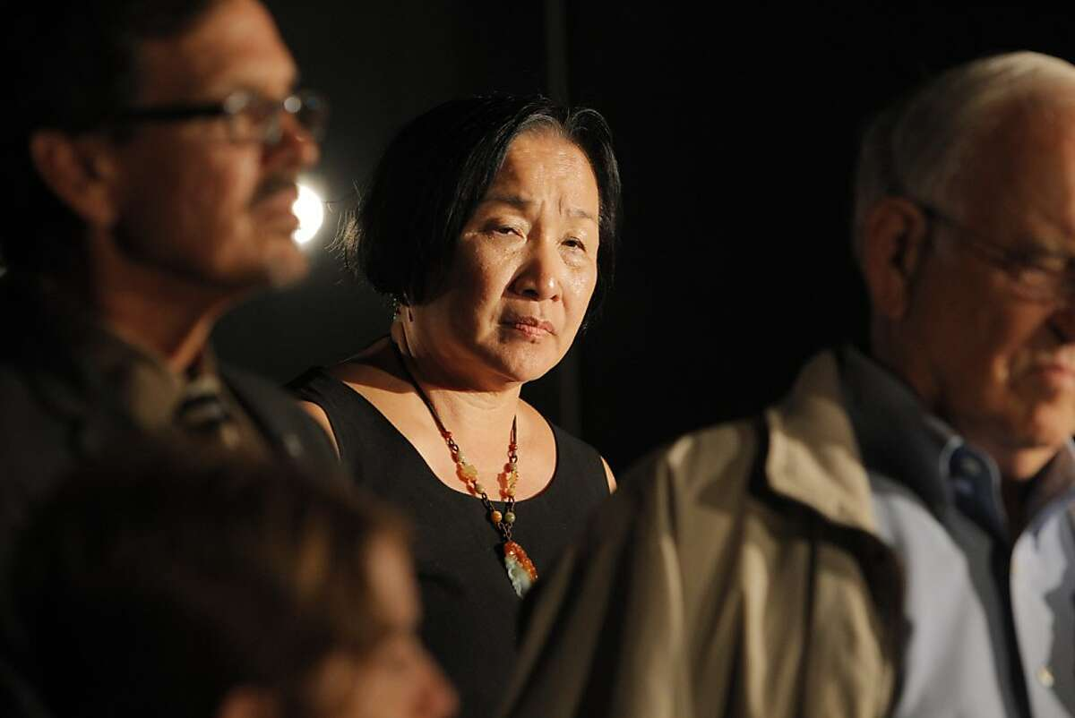 Oakland Mayor Jean Quan (center) has to fight low approval ratings in her bid for re-election.