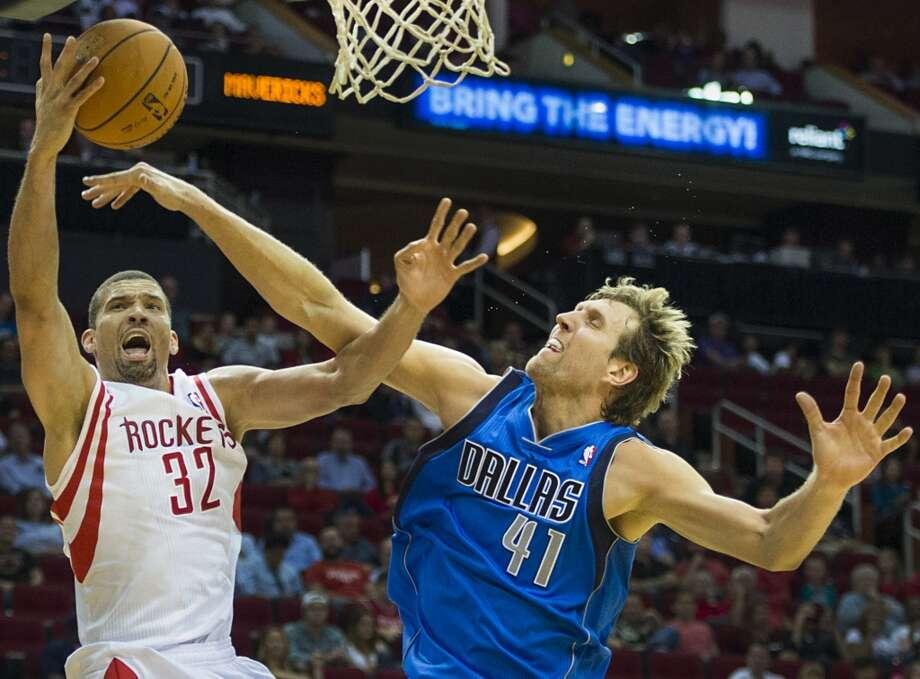 Rockets forward Francisco Garcia is fouled by Dirk Nowitzki of the Mavericks. Photo: Smiley N. Pool, Houston Chronicle