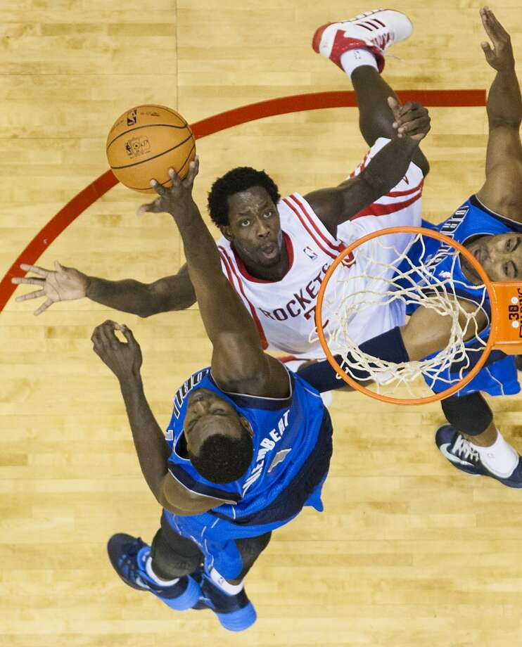 Rockets point guard Patrick Beverley has his shot blocked by Mavericks center Samuel Dalembert. Photo: Smiley N. Pool, Houston Chronicle