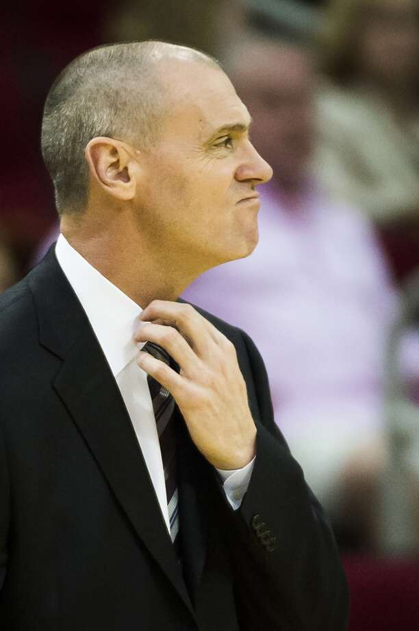 Dallas Mavericks head coach Rick Carlisle adjusts his tie during the first half of an NBA basketball game at Toyota Center on Monday, Oct. 21, 2013, in Houston. ( Smiley N. Pool / Houston Chronicle ) Photo: Smiley N. Pool, Houston Chronicle
