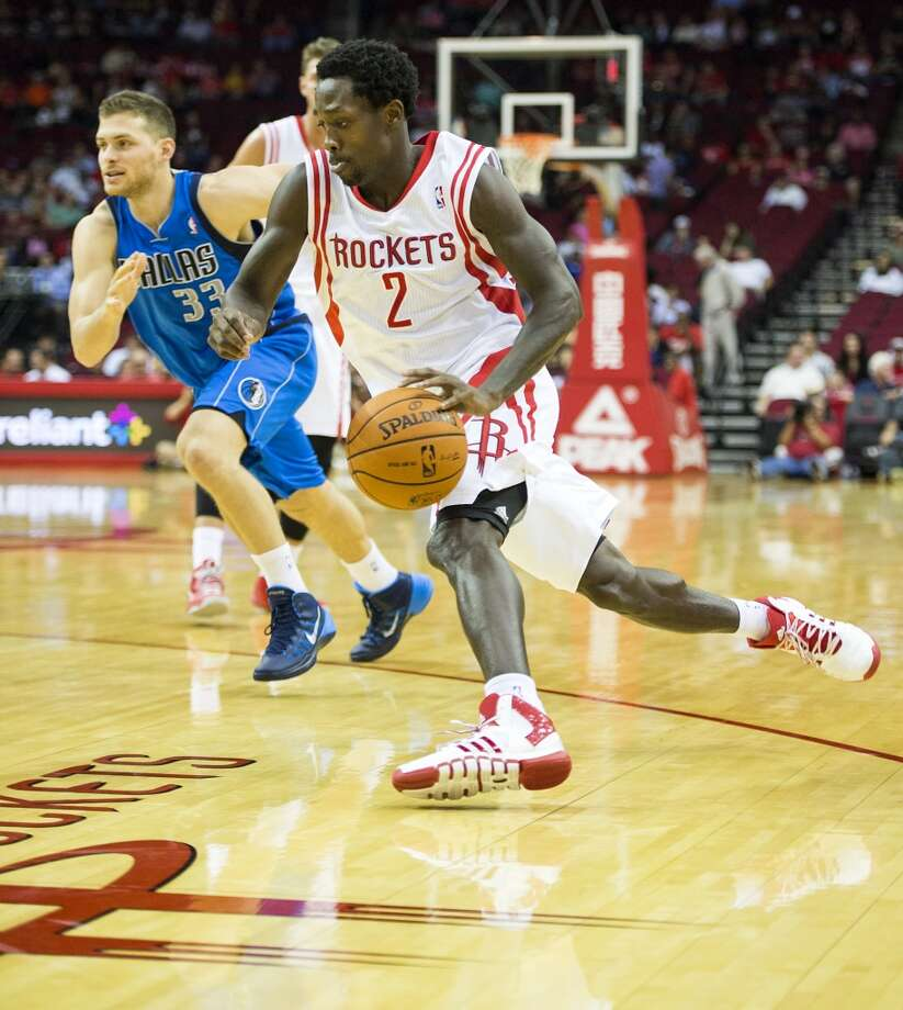 Rockets point guard Patrick Beverley drives around Mavericks point guard Gal Mekel. Photo: Smiley N. Pool, Houston Chronicle