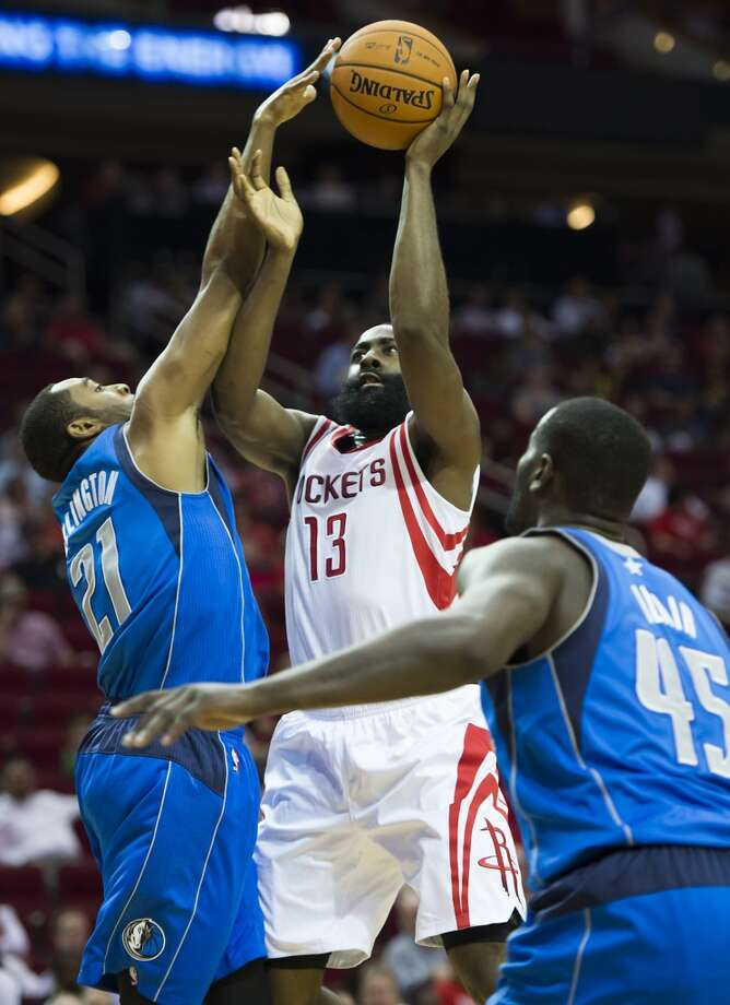 Houston Rockets shooting guard James Harden has his shot blocked by Mavericks guard Wayne Ellington. Photo: Smiley N. Pool, Houston Chronicle