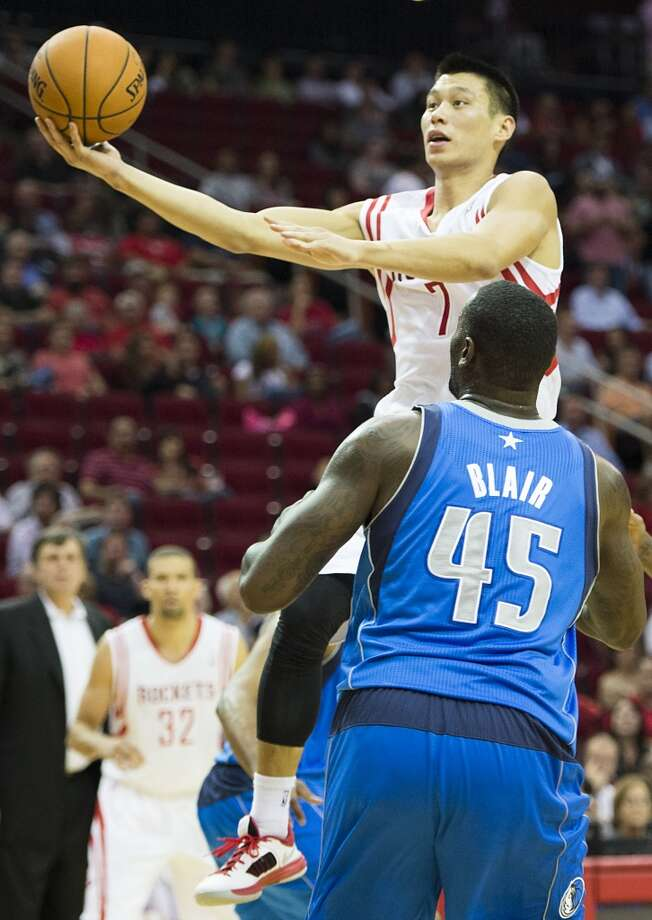 Rockets point guard Jeremy Lin drives past Mavericks center DeJuan Blair. Photo: Smiley N. Pool, Houston Chronicle