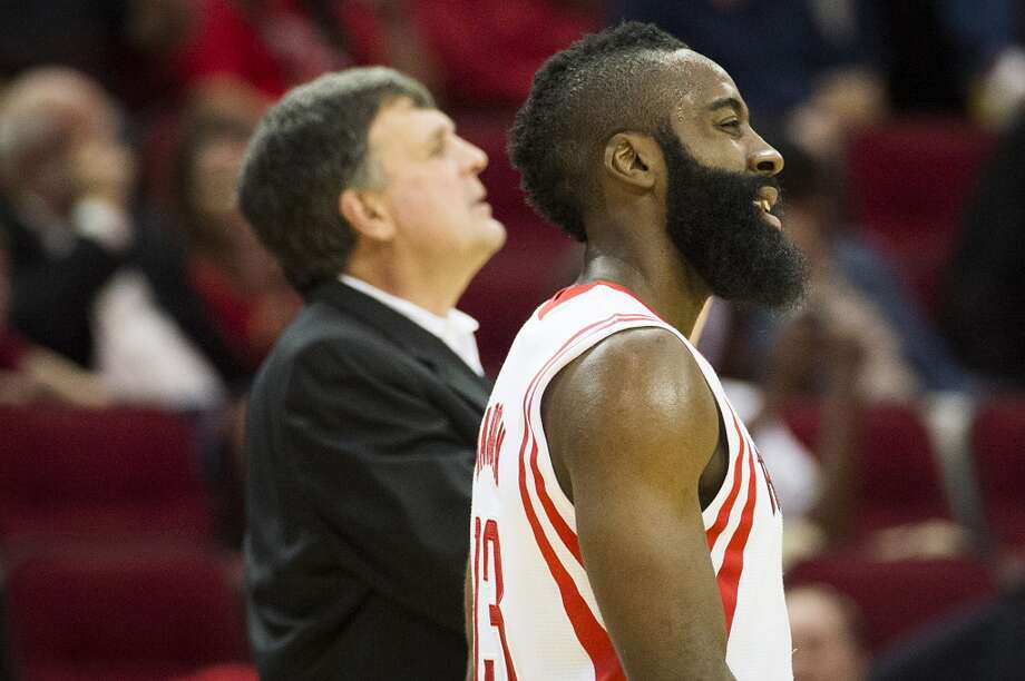 Rockets guard James Harden and head coach Kevin McHale watch during a break in the action. Photo: Smiley N. Pool, Houston Chronicle
