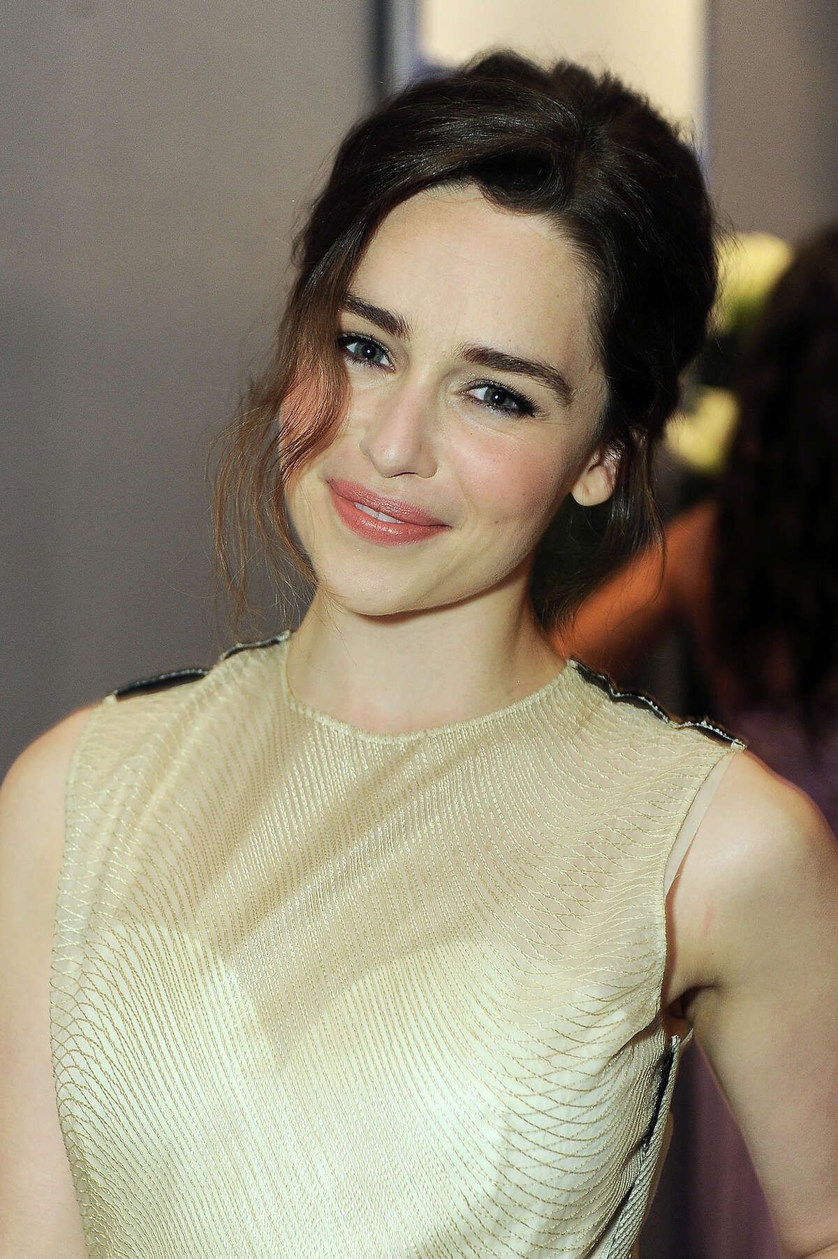 Actress Emilia Clarke attends the ELLE 20th annual