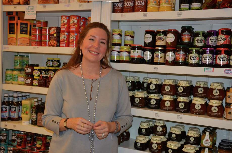 Goldenberry Manager Deb Hecht stands in front of one of the many shelves of specialty foods at the welcome and opening reception of the new shop, benefitting The New Canaan Beautification League, on Oct. 15, 2013, in New Canaan, Conn. Photo: Jeanna Petersen Shepard / New Canaan News Freelance