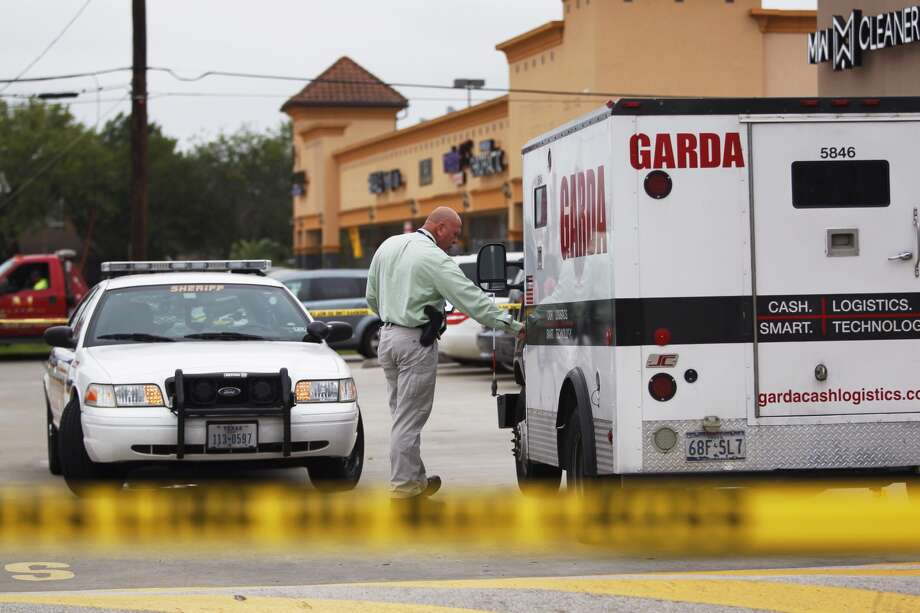 A guard fired on armed and masked men who attempted to rob an armored car at a bank near Spring this morning, according to the Harris County Sheriff's Office. (Johnny Hanson / Houston Chronicle)