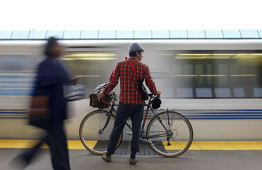 Adrian Silva waits for a BART train on the first day of service at the West Oakland Bart station in Oakland, Calif., Tuesday, Oct. 22, 2013. The four day long BART strike was resolved late Monday night. Photo: Nicole Fruge, The Chronicle