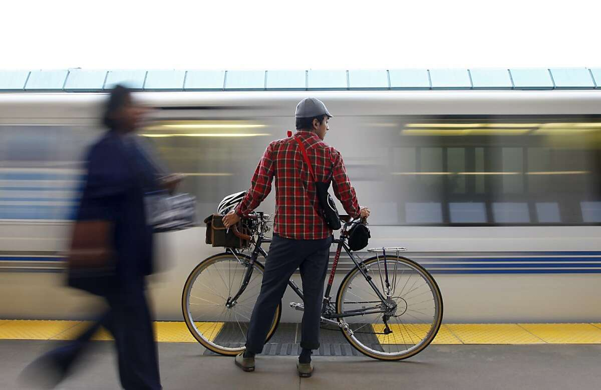 Adrian Silva waits for a BART train on the first day of service at the West Oakland Bart station in Oakland, Calif., Tuesday, Oct. 22, 2013. The four day long BART strike was resolved late Monday night.