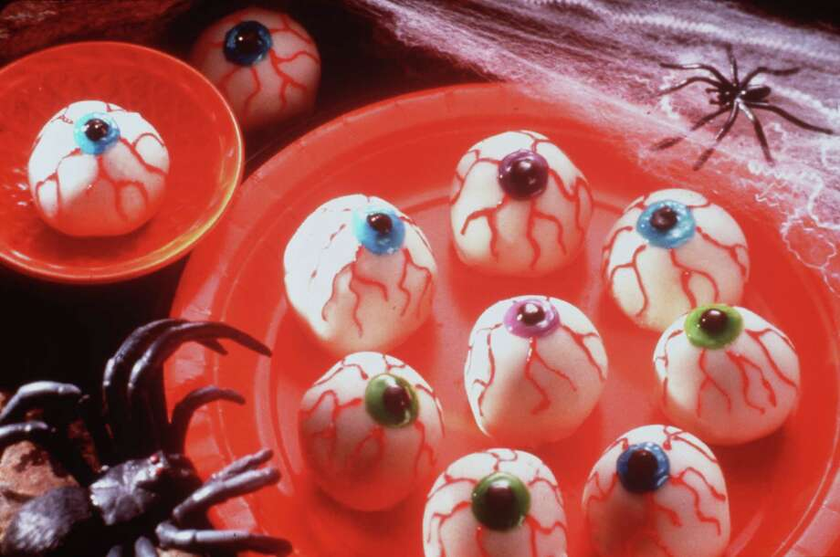 halloween.  no other info given.     HOUCHRON CAPTION (10/21/2002):  In Food: Halloween is the one night of the year when it's OK not to be yourself - maybe Dracula, a wicked witch or Frankenstein instead. But would any of those spooks touch a gourmet meal? Check out our recipes for Spider Web Soup, Ooglie Eyeballs (PICTURED), Bone Chillin' Stew and more.     HOUCHRON CAPTION (10/23/2002): Warm crumbled brownies are combined with dried cranberries and rolled into balls, then dipped in white chocolate and decorated to create Ooglie Eyeballs. Photo: No Info / handout slide