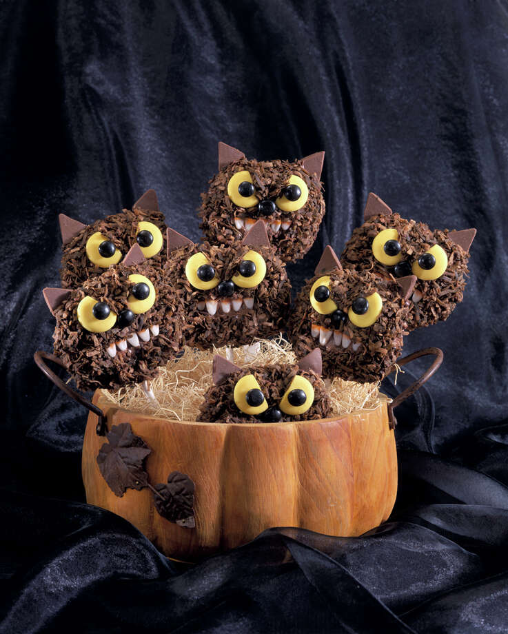 **  FOR USE WITH AP WEEKLY FEATURES ONLY** A pumpkin jack-o'-lantern makes a cheery container for a clutch of edible monsters, fuzzy chocolate Wolfman Cookie Pops, for youngsters to wolf down. Preparing the cookies can be a family project, with the children recruited to help decorate them. (AP Photo/Wilton Enterprises).    HOUCHRON CAPTION  (10/27/2003):  Halloween provides the perfect excuse for playing with your food. Reporter Claire Matheson talks to the experts and shares these ghoulishly fun recipes: Ancient Tomb Eggs, Wolfman Cookie Pops (PICTURED), Crunchy Donut Eyeballs, Jack-o'-Lantern Cookies and Red Devil Punch.     HOUCHRON CAPTION (10/29/2003): The kids can help decorate these Wolfman Cookie Pops, then wolf 'em down with some punch. Photo: HO / WILTON ENTERPRISES
