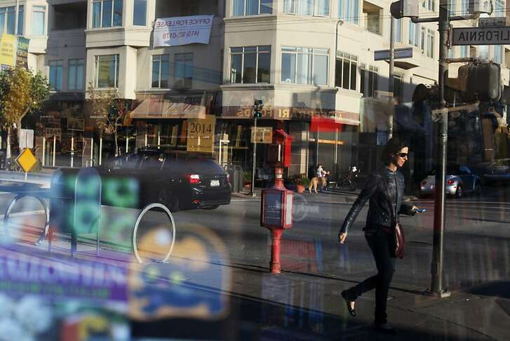 A pedestrian is reflected in the window of Books, Inc. on October 19, 2013 in the Laurel Heights area of San Francisco, Calif.