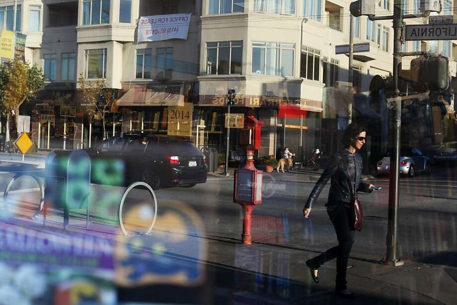A pedestrian is reflected in the window of Books, Inc. on October 19, 2013 in the Laurel Heights area of San Francisco, Calif. Photo: Pete Kiehart, The Chronicle
