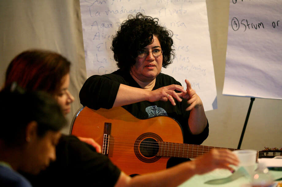 Lourdes Perez conducts a songwriting workshop at  Esperanza Peace and Justice Center last week. She is performing with Venezuelan singer Irene Farrera this weekend. Photo: For San Antonio Express-News