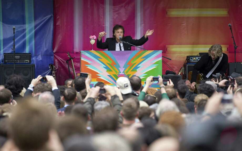 "Paul McCartney performs during an impromptu gig in  London earlier this month to promote ""New."" Photo: AFP / Getty Images"