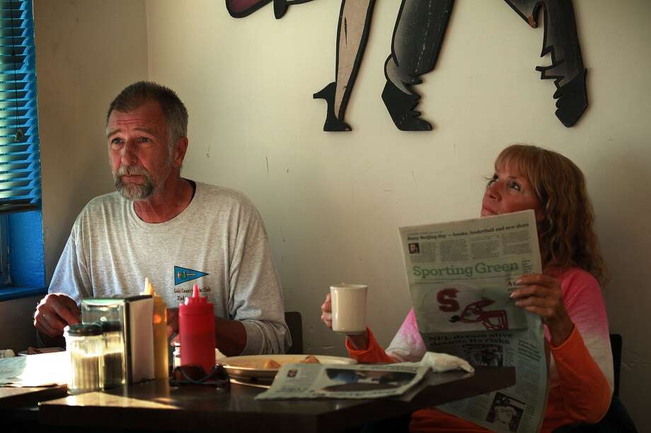 Dudley Gaman (left) and his wife Teresa Gaman from Grass Valley have breakfast while they catch up on the news at Java House in San Francisco. Photo: Liz Hafalia, The Chronicle