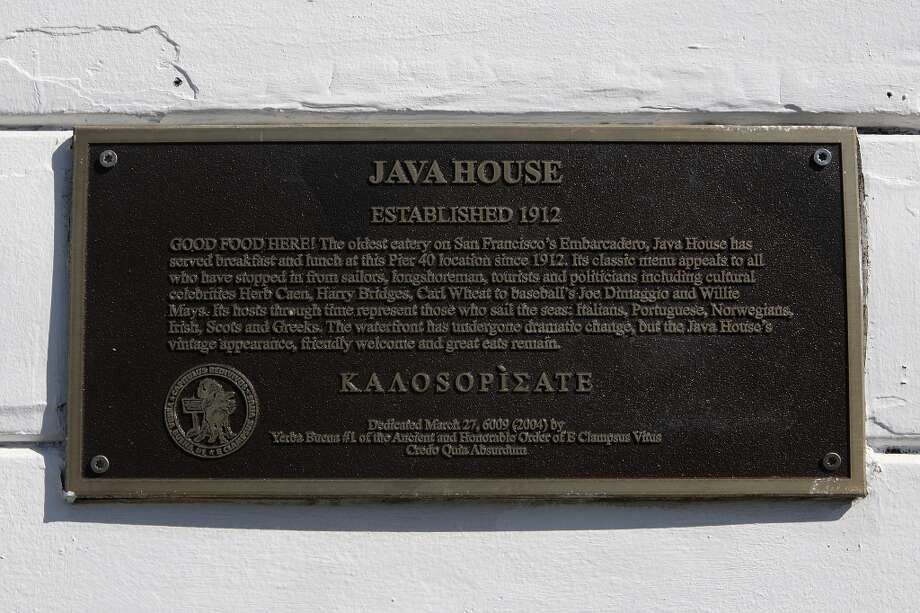 A plaque next to the front door of the Java House in San Francisco, California, states the restaurant as 'The oldest eatery on San Francisco's Embarcadero' Photo: Liz Hafalia, The Chronicle