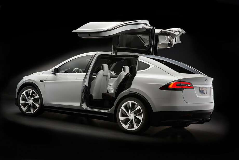 Consumers looking for a hot ride without the heat can stay away from the Model S and take advantage of the new 2014 Tesla Model X, expected to launch sometime in 2014. Photo: Handout, McClatchy-Tribune News Service