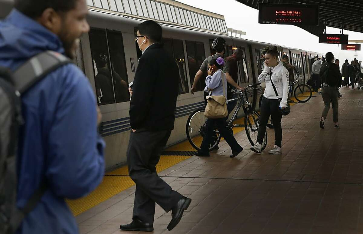 Bay Area Rapid Transit passengers board a BART train Tuesday, Oct. 22, 2013, in Oakland.