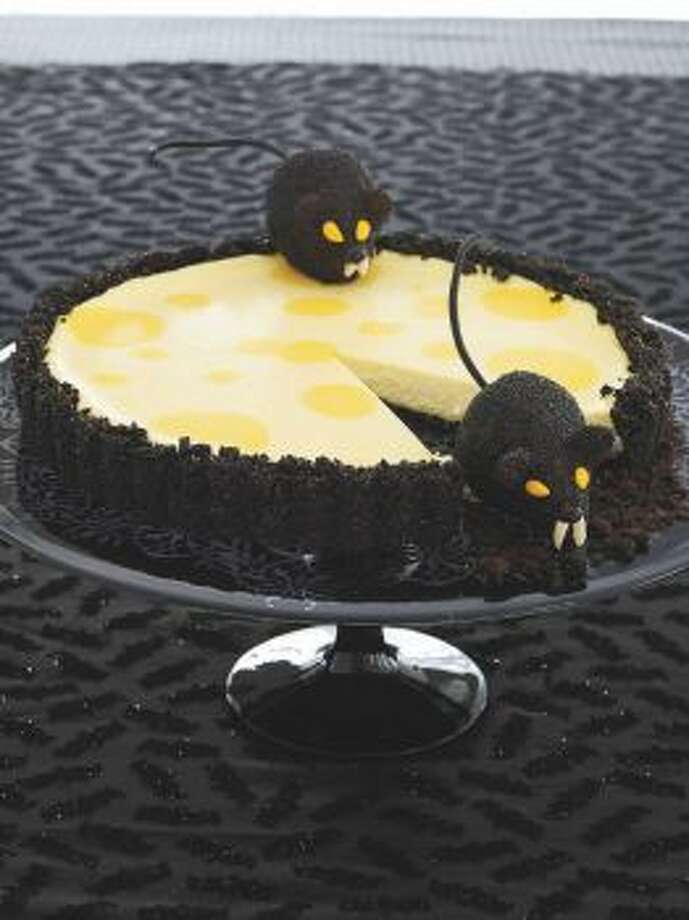 Creepy Critter CheesecakeCheesecake and chocolate wafers take on their creepiest form in this dessert.