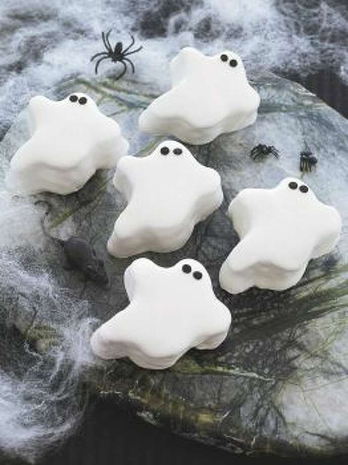 Pumpkin GhostsLet ghostly cookie cutters turn pumpkin cake into scary treats. Read the recipe