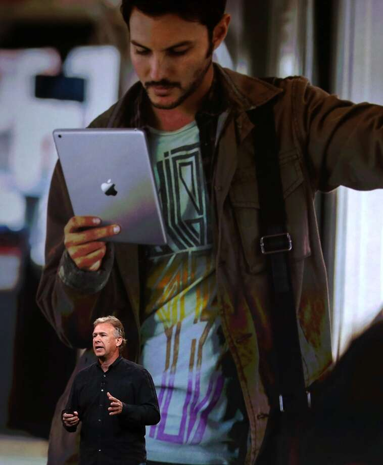 Apple Senior Vice President of Worldwide Marketing Phil Schiller announces the new iPad Air during an Apple announcement at the Yerba Buena Center for the Arts on October 22, 2013 in San Francisco, California. The tech giant announced its new iPad Air, a new iPad mini with Retina display, OS X Mavericks and highlighted its Mac Pro. Photo: Justin Sullivan, Getty Images