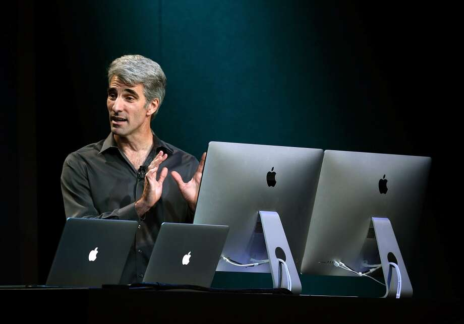 Apple Senior Vice President of Software Engineering Craig Federighi speaks during an Apple announcement at the Yerba Buena Center for the Arts on October 22, 2013 in San Francisco, California. The tech giant is expected to announce its new iPad 5, iPad mini 2, OS X Mavericks and possibly a new retina MacBook Pro. Photo: Justin Sullivan, Getty Images