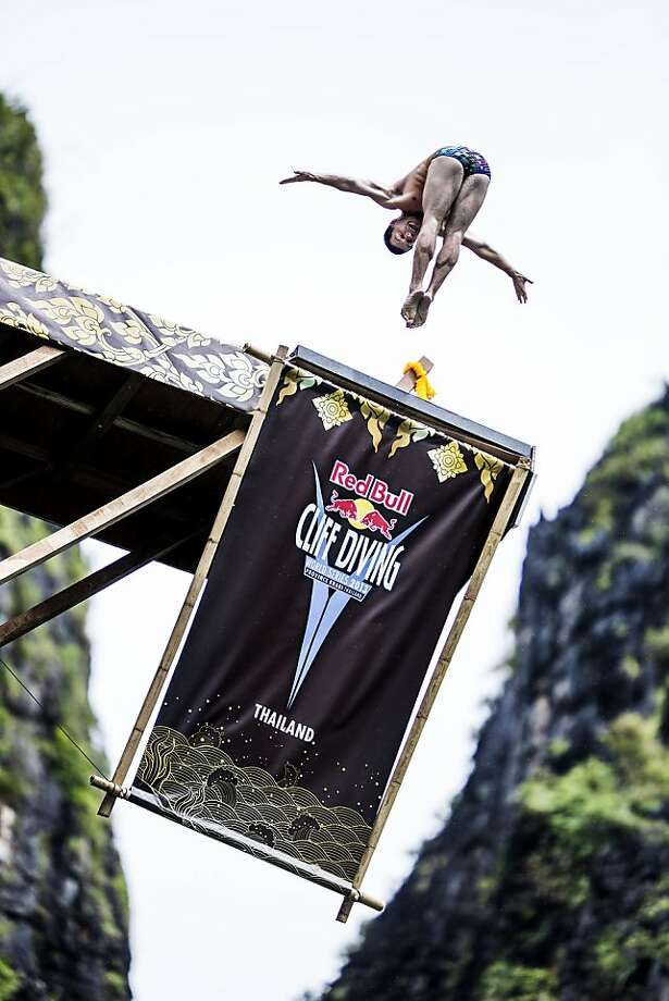 In this handout image provided by Red Bull, Steven LoBue of the USA dives from the 27 metre platform at Maya Bay in the Andaman Sea during the final stop of the 2013 Red Bull Cliff Diving World Series on October 19, 2013 at Phi Phi Island, Thailand. Photo: Handout, Red Bull Via Getty Images