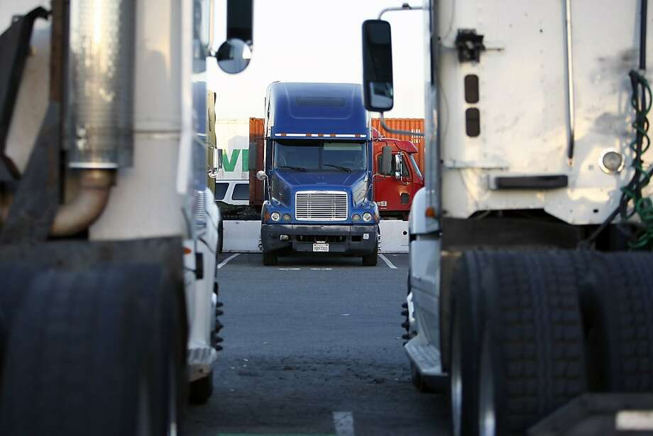 Trucks pull into the Port of Oakland last month. Some drivers are striking this week. Photo: Michael Short, The Chronicle
