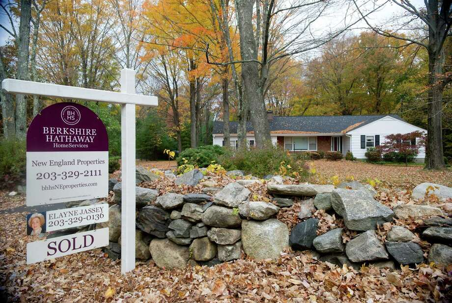 "A ""sold"" sign hangs outside the home at 165 Haviland Road in Stamford, Conn., on Tuesday, October 22, 2013. Photo: Lindsay Perry / Stamford Advocate"