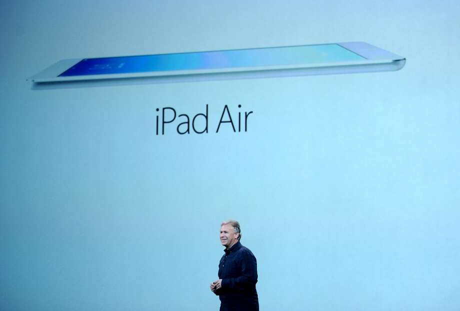 Philip Schiller, senior vice president of worldwide marketing at Apple Inc., unveils the iPad Air during a press event at the Yerba Buena Center in San Francisco, California, U.S., on Tuesday, Oct. 22, 2013. Apple Inc. debuted the new high-definition iPad Air tablet computer today. Photo: Noah Berger, Bloomberg