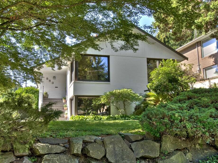 First up is 553 N.E. 130th St. The 2,600-square-foot house built in 1951, has three bedrooms, 1.75 bathrooms, two fireplaces, a family room, a patio and a two-car carport on a 7,707-square-foot lot. It's listed for $410,000. Photo: Seattle Home Pics,  Courtesy Sarah Rudinoff,  John L. Scott Real Estate