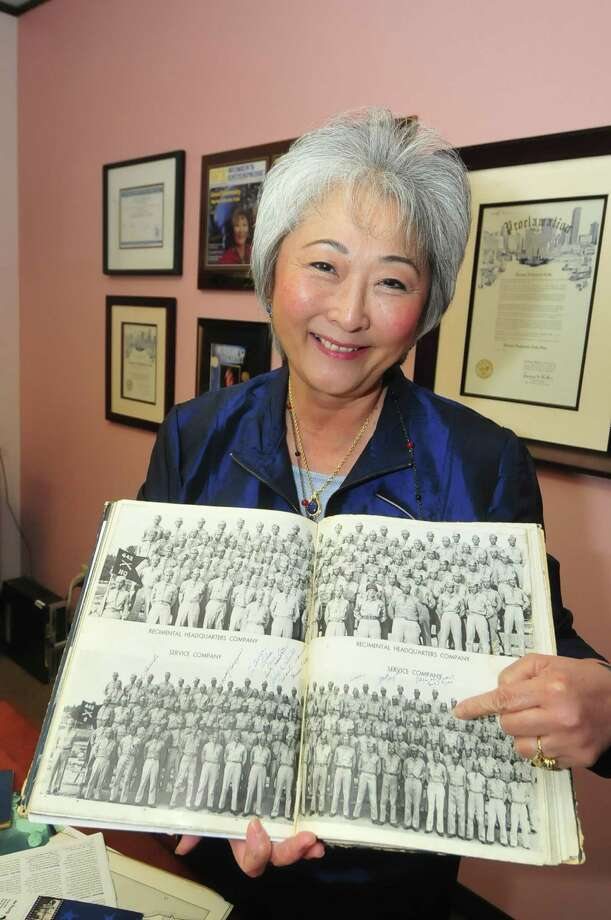 Donna Cole  shows where her father is in a 1943 photo of the Army 442nd Combat Team, which has been honored for its role in World War II. Photo: Â Tony Bullard 2013, Freelance Photographer / © Tony Bullard & the Houston Chronicle