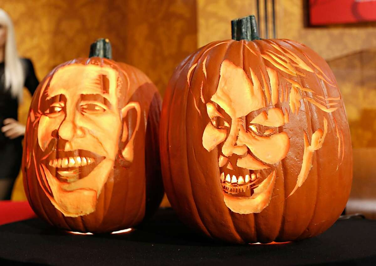 Pumpkins carved in the likeness of President Barack Obama and First Lady Michelle Obama are displayed as Madame Tussauds New York kicks off a special Halloween weekend featuring a live pumpkin carving performance at Madame Tussauds New York on October 22, 2013 in New York City.