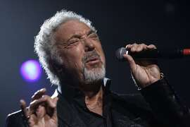 FILE - In this Sept. 24, 2009 file photo, singer Tom Jones performs at the Guinness 250th Anniversary Celebration at the Guinness storehouse in Dublin, Ireland.