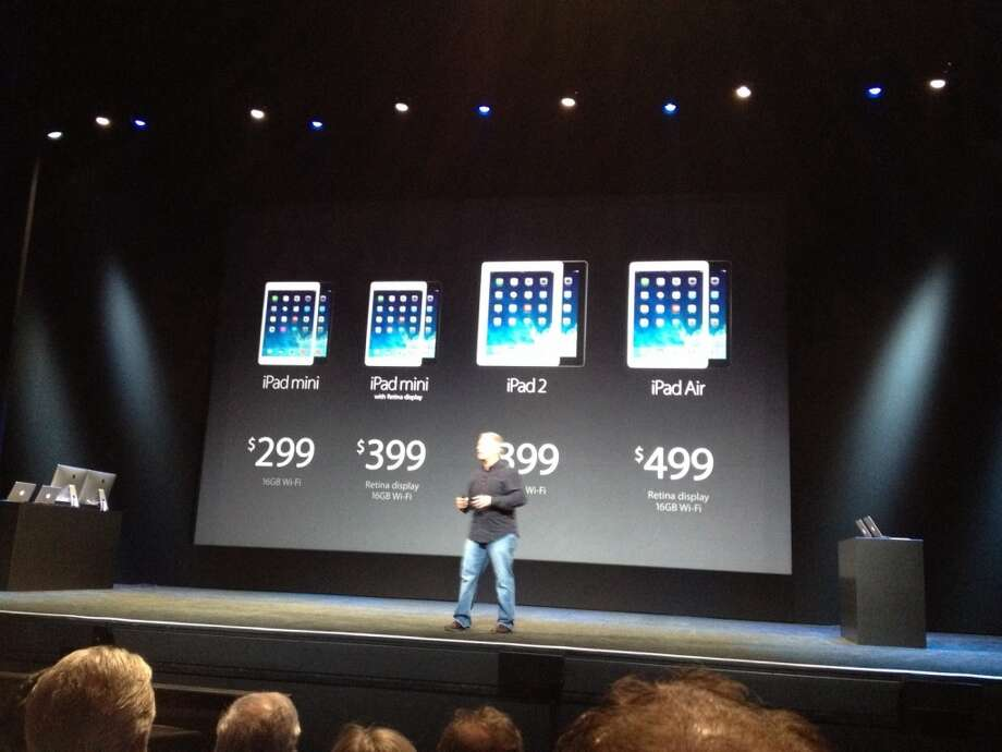 CEO Tim Cook with the new iPad lineup Photo: Benny Evangelista, The Chronicle