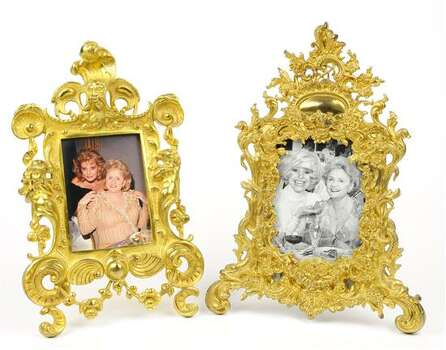 TWO GILT BRONZE FRAMES WITH CELEBRITY PHOTOS 