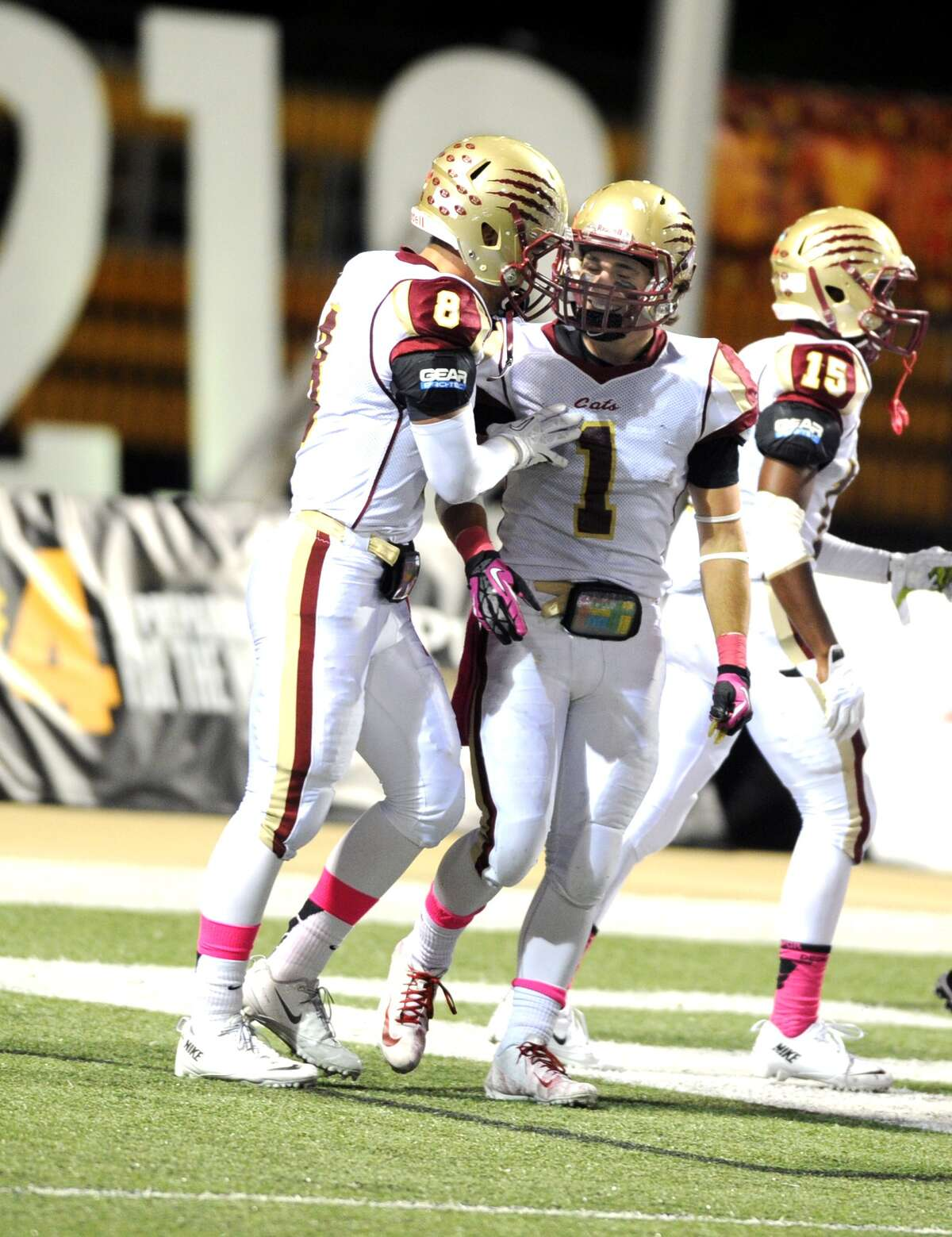 Cy Woods and Cy Ranch played a football game at The Berry Center, 10-19-13. Cy Woods won the game, 54-0. Left, Chris England (8) congratulates receiver Mason Roberts (1) after Roberts scored a touchdown.