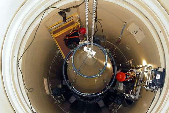 "In this image released by the U.S. Air Force, a Malmstrom Air Force Base missile maintenance team removes the upper section of an ICBM at a Montana missile site. An Air Force unit that operates one-third of the nation's land-based nuclear missiles at Malmstrom Air Force Base, Mont., has failed a safety and security inspection, marking the second major setback this year for a force charged with the military's most sensitive mission, Lt. Gen. James M. Kowalski, who is in charge of the nuclear air force told The Associated Press on Tuesday, Aug. 13, 2013. He said a team of ""relatively low ranking"" airmen failed one exercise as part of a broader inspection, which began last week and ended Tuesday. He said that for security reasons he could not be specific about the team or the exercise.  (AP Photo/U.S. Air Force, John Parie)"