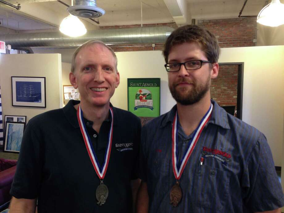 Saint Arnold founder Brock Wagner and brewer Stephen Rawlings show off the 2013 Great American Beer Festival medals earned for Summer Pils and Weedwacker. Photo: Ronnie Crocker