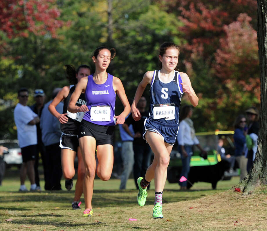 At left, Claire Howlett of Westhill High School battles Hannah DeBalsi, right, of Staples High School, during the FCIAC girls high school cross country championships at Waveny Park, New Canaan, Thursday, Oct. 17, 2013.DeBalsi finished first in the race and Howlett second. Photo: Bob Luckey / Greenwich Time