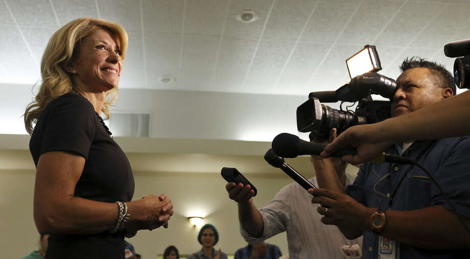 State Sen. Wendy Davis, who is running for Texas governor, answers questions from the media on Oct. 7. A San Antonio Express-News reader defends Davis against criticism she has received since announcing her candidacy for the Democratic nomination. Photo: Edward A. Ornelas / San Antonio Express-News