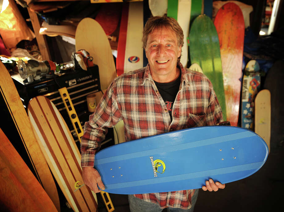 Michael Shore, of Trumbull, started his skateboard company, Shoreboardz, in the garage of his home. Shore, a surfer, wanted to design skateboards that ride and turn more like surfboards. Photo: Brian A. Pounds / Connecticut Post