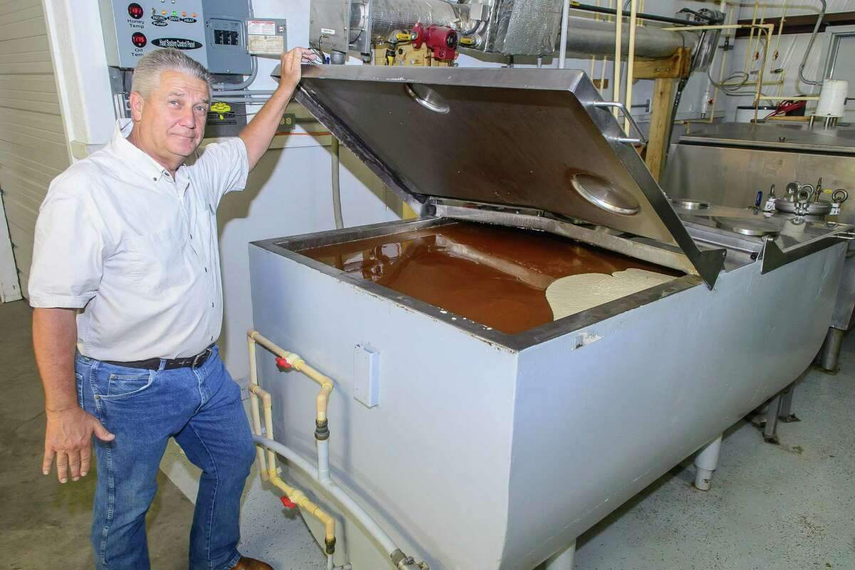 Jerry Stroope stores honey extracted from some hives at the Stroope Honey Farms in Pearland.